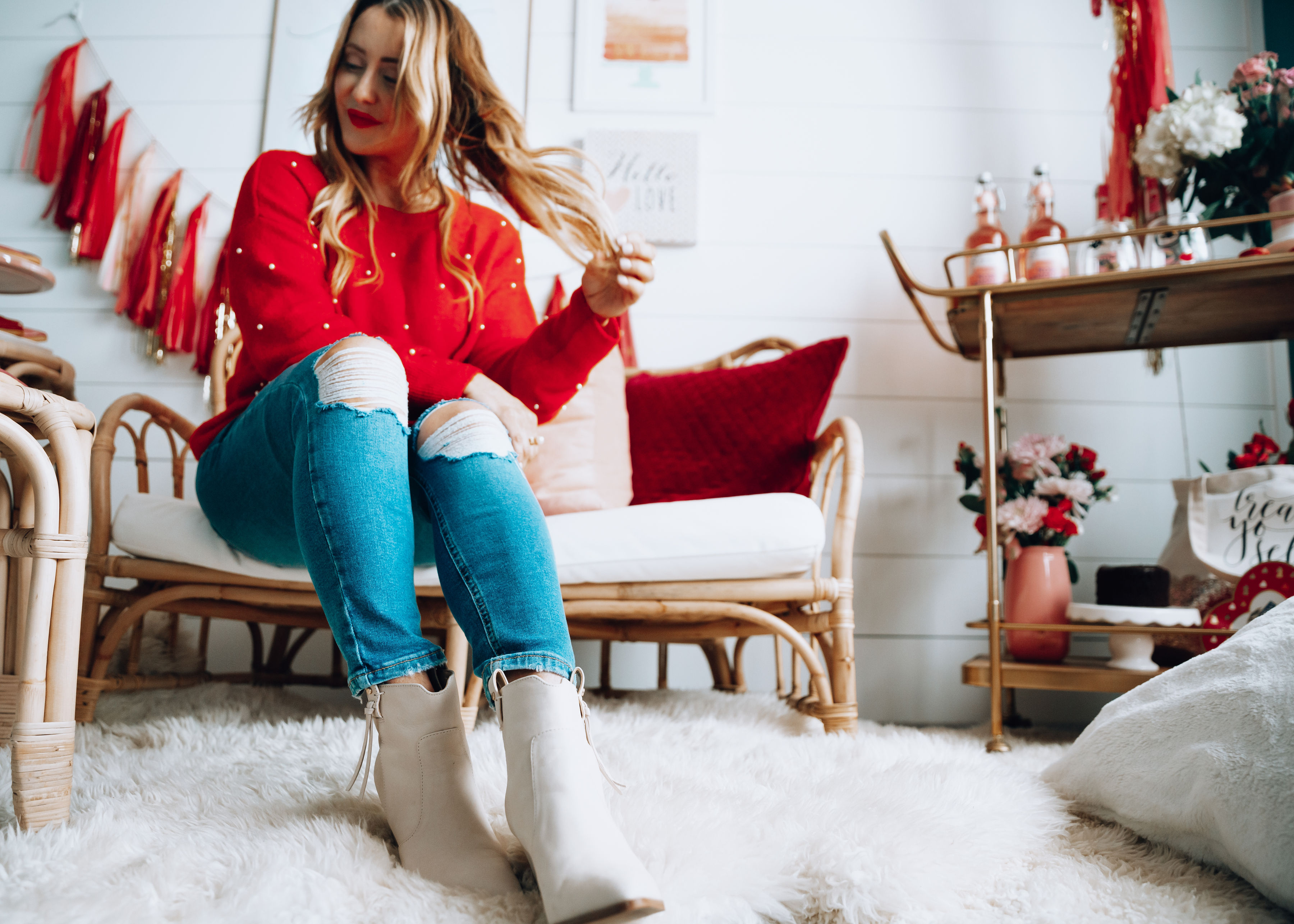 5 Ways to Treat YourSelf This Valentine's Day featured by top life and style blog, For the Love: image of a woman wearing a H&M red sweater, Marc Fisher booties, TOPSHOP ripped denim