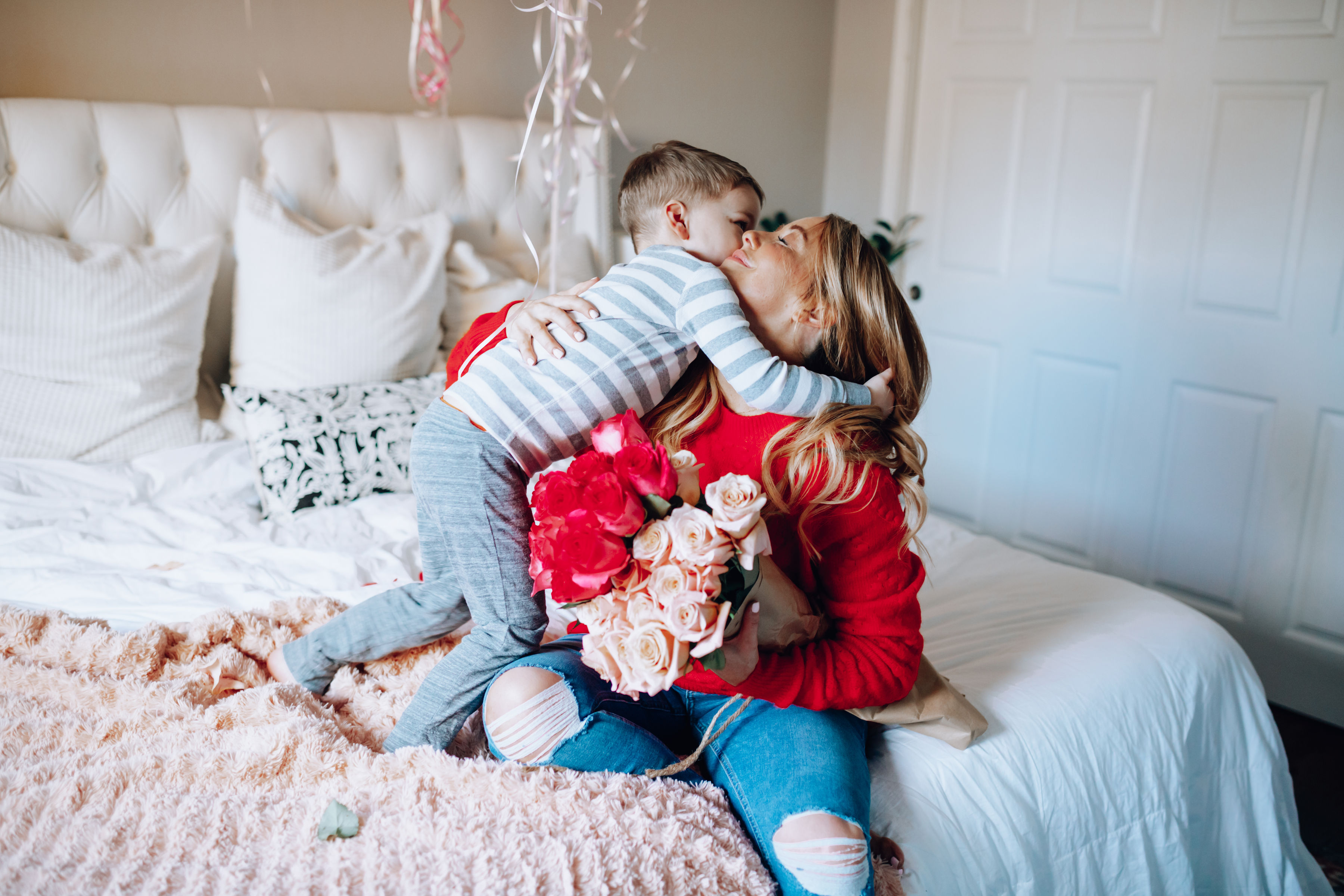 The Best Valentine's Day Sales featured by top US fashion blog, For the Love: image of a boy embracing his mother